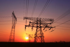 The transmission tower silhouette of the evening stock photo