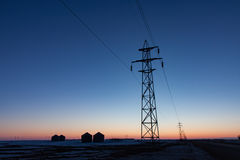 Transmission Tower Silhouetted at Sunset. Horizontal format of Transmission Tower Silhouetted at Sunset stock photography