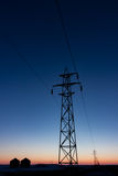 Transmission Tower Silhouetted at Sunset Vertically. Vertical format of Transmission Tower Silhouetted at Sunset Stock Image