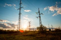 Transmission tower. On sunset background royalty free stock image