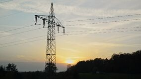 Transmission tower during sunset. Silhouette of a transmission towers during sunset. Silhouette of power lines during sunset