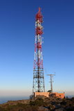 Transmission tower on top of mountain. A transmission tower on top of a mountain Royalty Free Stock Photos