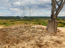 Transmission tower through the valley. Of the summer day royalty free stock images