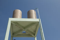 Transmission tower water. Treatment in tempel fand blue sky stock photo
