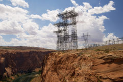 Transmission Towers. Large transmission towers carry the high voltage lines from a hydroelectric power station Royalty Free Stock Photos