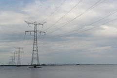 Transmission towers in river Royalty Free Stock Photos