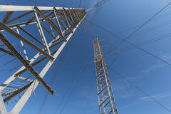 Transmission towers in the sky Stock Photos