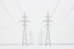 Transmission Towers To Horizon in Winter, Horizontal Crop Royalty Free Stock Images