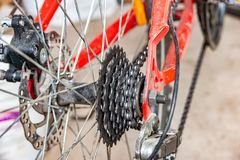 Transmissions and brakes on the bike, chain, sprocket and disc brakes.  stock images