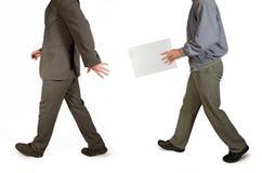 Transmit envelope. Two walking men transmit envelope Royalty Free Stock Photos