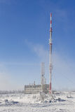 Transmitter. In winter with the blue sky as backgroun Royalty Free Stock Photo