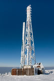 Transmitter. In winter with the blue sky as backgroun Royalty Free Stock Images