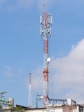 Transmitter and cellular tower on roof top Royalty Free Stock Images