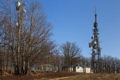 Transmitter on the forest background Royalty Free Stock Photo