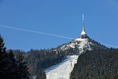 Transmitter and lookout tower in a winter landscape on the hill Jested. Royalty Free Stock Images