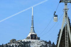 Transmitter and lookout tower in a winter landscape on the hill Jested. Stock Photos