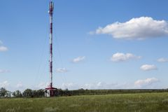 Cellular GSM tower in sunny summer day Royalty Free Stock Photo