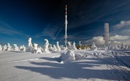 Transmitter in the mountains. Snowy transmitter in the mountains Stock Images