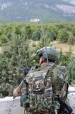 Transmitter radio operator gunner M249  light machine gun. Radio operator gunner with light machine gun m 249 Royalty Free Stock Images