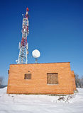 Transmitter and red brick house Stock Photo