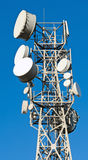 Transmitter tower against Royalty Free Stock Photos