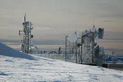Transmitter towers on a hill in winter Royalty Free Stock Photos