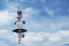 Transmitting aerial. Against a blue sky with white clouds Stock Image