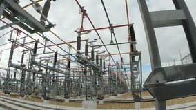 Transmitting Electricity Construction against Cloudy Sky. Transmitting electricity construction with electric high voltage wires in cloudy sky background on stock footage