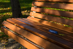 Transmitting a message. Happiness message left on a bench on a sunny afternoon. Communication in another form Royalty Free Stock Photography