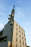 Transmitting station. In a peak under blue sky Royalty Free Stock Images