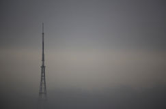 Transmitting Station in mist. The high Crystal Palace transmitting station covered in mist at dawn, Bromley, London, UK Royalty Free Stock Photography