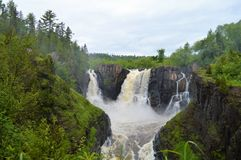 High Falls of the Pigeon River in Grand Portage, Minnesota, USA is a transnational river waterfalls. Transnational river waterfalls are visible in Grand Portage Royalty Free Stock Photography