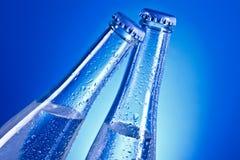 Transparante flessen met GLB Stock Afbeeldingen