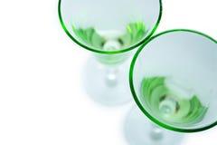 Transparante groene glazen op wit Stock Foto