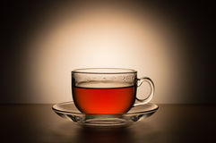 Transparante kop thee op een achtergrond van witte vlekken Royalty-vrije Stock Foto