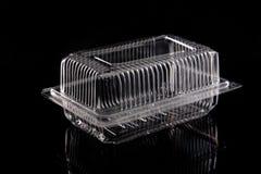 Transparante plastic doos op zwarte achtergrond. Royalty-vrije Stock Afbeeldingen