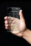 Transparante smartphone met hand op donkere achtergrond Stock Fotografie