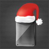 Transparency glass plate with santa claus hat Royalty Free Stock Photography