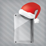 Transparency glass plate with santa claus hat Royalty Free Stock Photo