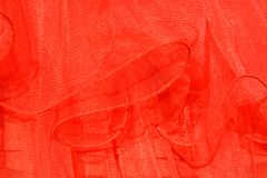 Transparency. Red rhythmic dress folds pointing out the transparency and easy texture of the object Royalty Free Stock Images
