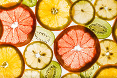 Transparency sliced fruits on white background Royalty Free Stock Photography