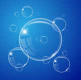 Transparent air bubble on the blue background Royalty Free Stock Photos