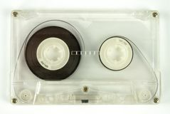 Transparent audio cassette on white background.  royalty free stock image