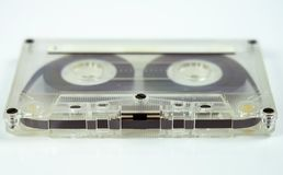 Transparent audio cassette on white background.  royalty free stock photo