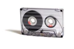 Transparent audiocassette. Black, transparent audiocassette on a white background Royalty Free Stock Image