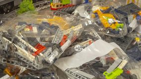 Transparent bags with pieces of LEGO to be used for toys construction royalty free stock images