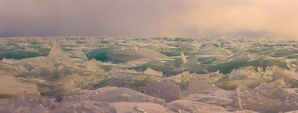Transparent Baikal ice hummocks at sunset in the fog.  Stock Photo