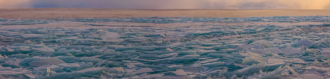 Transparent Baikal ice hummocks at sunset in the fog Stock Images