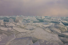 Transparent Baikal ice hummocks at sunset in the fog.  Stock Photography