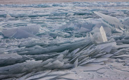 Transparent Baikal ice hummocks at sunset in the fog.  Stock Images